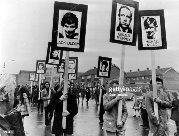 Marchers carry signs for deceased on the oneyear anniversary of 'Bloody Sunday' January 31 1973 in Londonderry Northern Ireland Thousands of people...