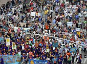 Marchers come down 6th Ave during the People's Climate March on September 21 2014 in New York Activists mobilized in cities across the globe Sunday...