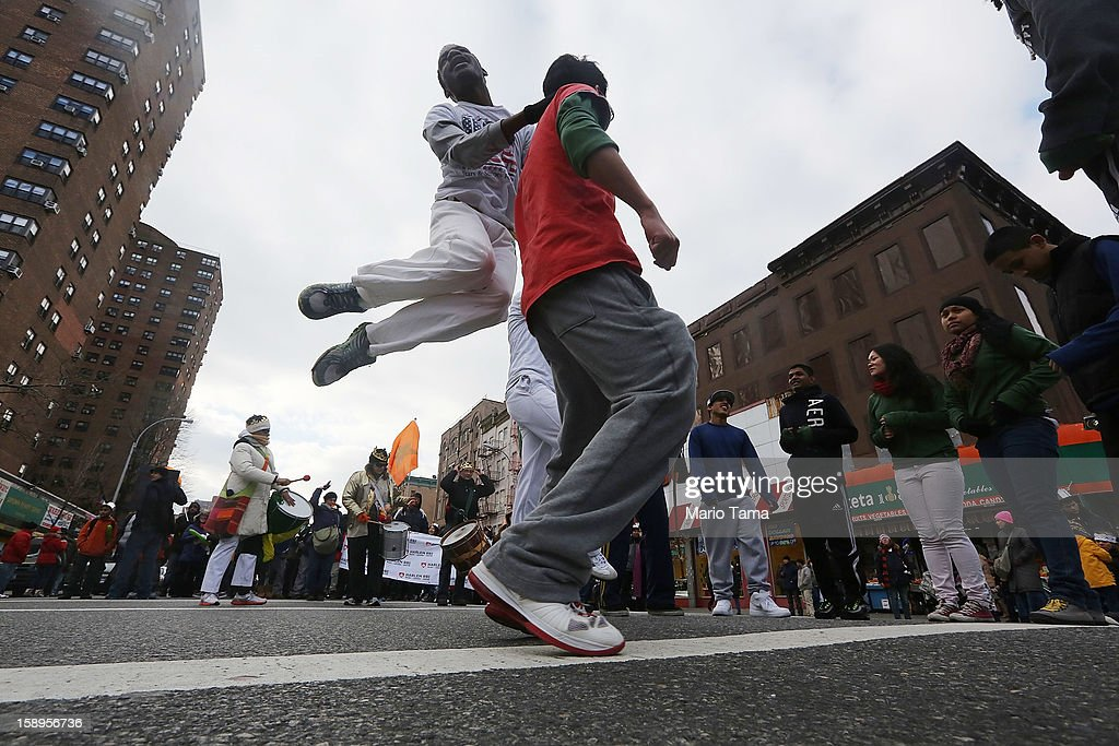 Marchers dance during the Three Kings Day Parade in East Harlem on January 4, 2013 in New York City. The parade celebrates the Feast of the Epiphany, also known as Three Kings Day, marking the Biblical story of the visit of three kings to Bethlehem to visit the baby Jesus, revealing his divinity.