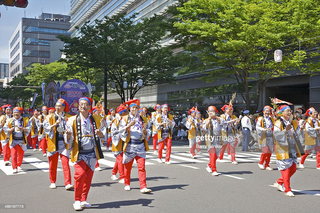 Marchers dressed in colorful costumes in parade