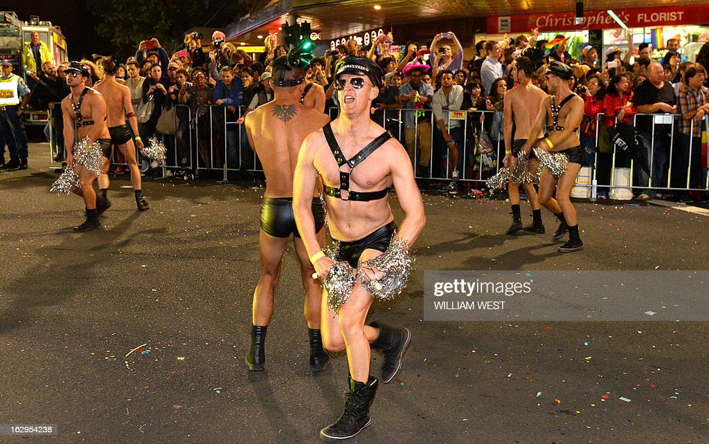 Marchers entertain the crowds in Sydney's annual Mardi Gras gay pride parade, an event which bills itself as the world's biggest night parade, on March 2, 2013. The Mardi Gras is in its 35th year and is celebrating the theme 'Generations of Love', focused on its origins as a gay rights protest march that ended with violence and arrests. Some 10,000 revellers on 115 individual floats made the journey down Oxford Street, hub of Sydney's gay and lesbian nightlife, in a vibrant show featuring drag queens, political parodies and plenty of sparkle. AFP PHOTO/William WEST