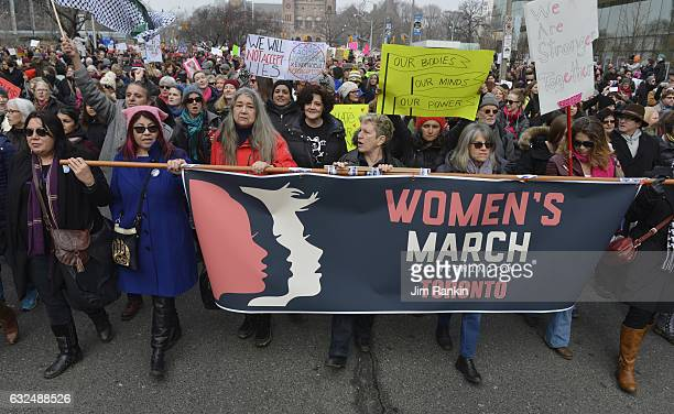 TORONTO ON JAN 21 Marchers head south on Univesrity Ave Thousands of women and girls and their families took to the streets of Toronto Saturday in a...