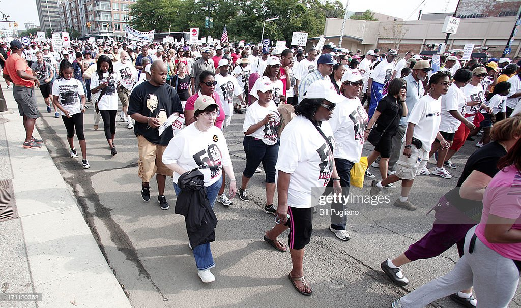 Marchers participate in the 50th Anniversary Commemorative Freedom Walk June 22, 2013 in Detroit, Michigan. The march commerates the 50th anniversary of Dr. Martin Luther King's Walk To Freedom.