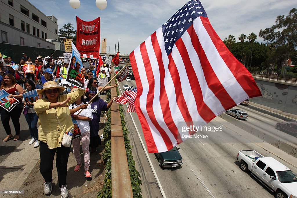 Marchers pass next to the 101 freeway on their way to the Metropolitan Detention Center during one a several May Day immigrationthemed events on May...