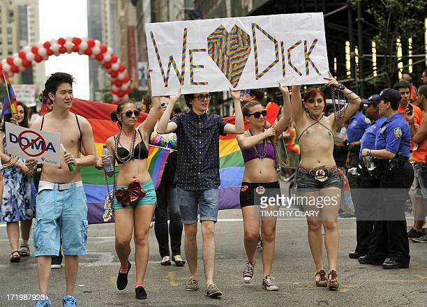 Marchers walk down 5th Avenue during the 2013 New York Gay Pride March in New York on June 30 2013 The 44th annual parade with more than 500000...