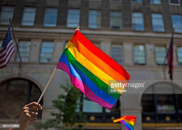 Marchers walk down 5th Avenue during the 2014 Gay Pride March on June 29 2014 in New York City Thousands of marchers attended the parade route which...