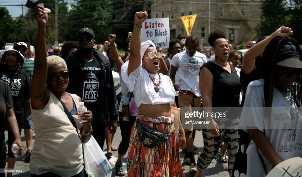Marchers walk through the Homewood neighborhood during their Black Brilliance Collective: March and Gathering August 19, 2017 in Pittsburgh, Pennsylvania. Just one week after the violent 'Unite the Right' rally in Virginia that left one woman dead and dozens more injured people have come out in solidarity with Charlottesville and to protect their neighborhoods.