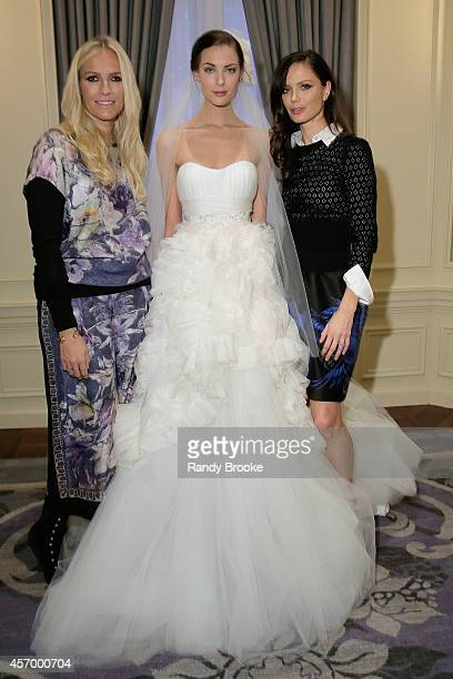 Marchesa designers Keren Craig and Georgina Chapman pose after the presentation with a model wearing one of their latest Bridal looks on October 10...