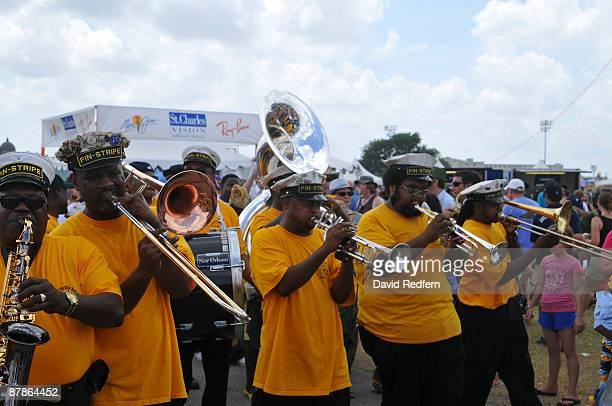 Marching band and New Generation and Undefeated Divas Social Aid Pleasure Clubs with Pinstripe Brass Band Marching in festival grounds at the New...