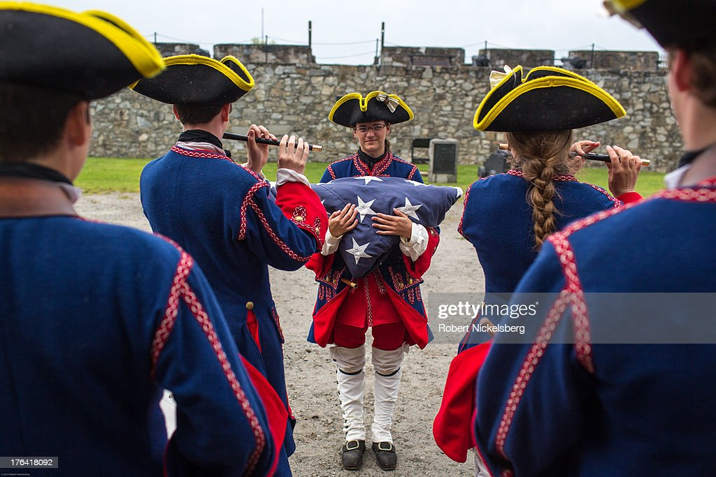 A marching band at Fort Ticonderoga dressed as French soldiers from 1755 plays a striking the colors tune for lowering the flag August 1, 2013 in Ticonderoga, New York. The large 18th-century fort was built and completed by the French in 1757 at the south end of Lake Champlain during the French and Indian War. The fort was of strategic importance during the 18th-century colonial conflicts between Great Britain and France in the settling of North America and played a role during the American Revolutionary War.