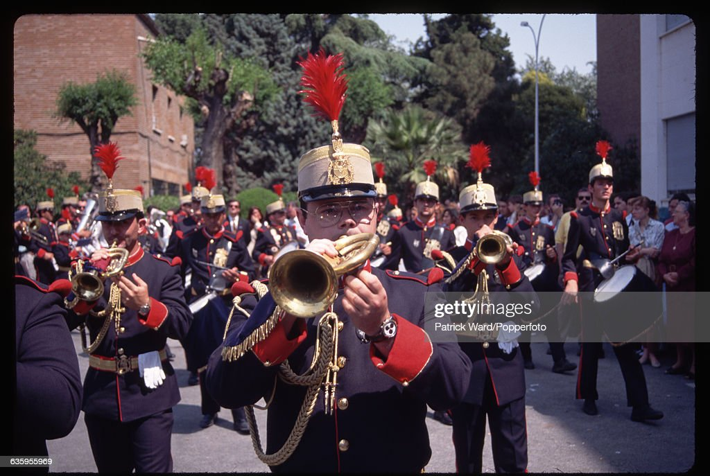 A marching band join a Holy Week procession in Seville, Spain.