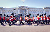 Marching band outside ornate building