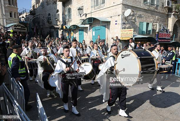 Marching band parades as Christians gather outside the Nativity Church which is considered to be located over the cave that marks the birthplace of...