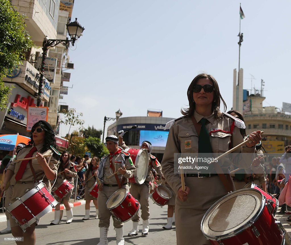 Marching band perform during the 'Holy Fire' parade on Holy Saturday ahead the Easter at the streets of Ramallah in West Bank on April 30, 2016. Holy Fire is described by Orthodox Christians as a miracle that occurs every year at the Church of the Holy Sepulchre in Jerusalem on Holy Saturday.