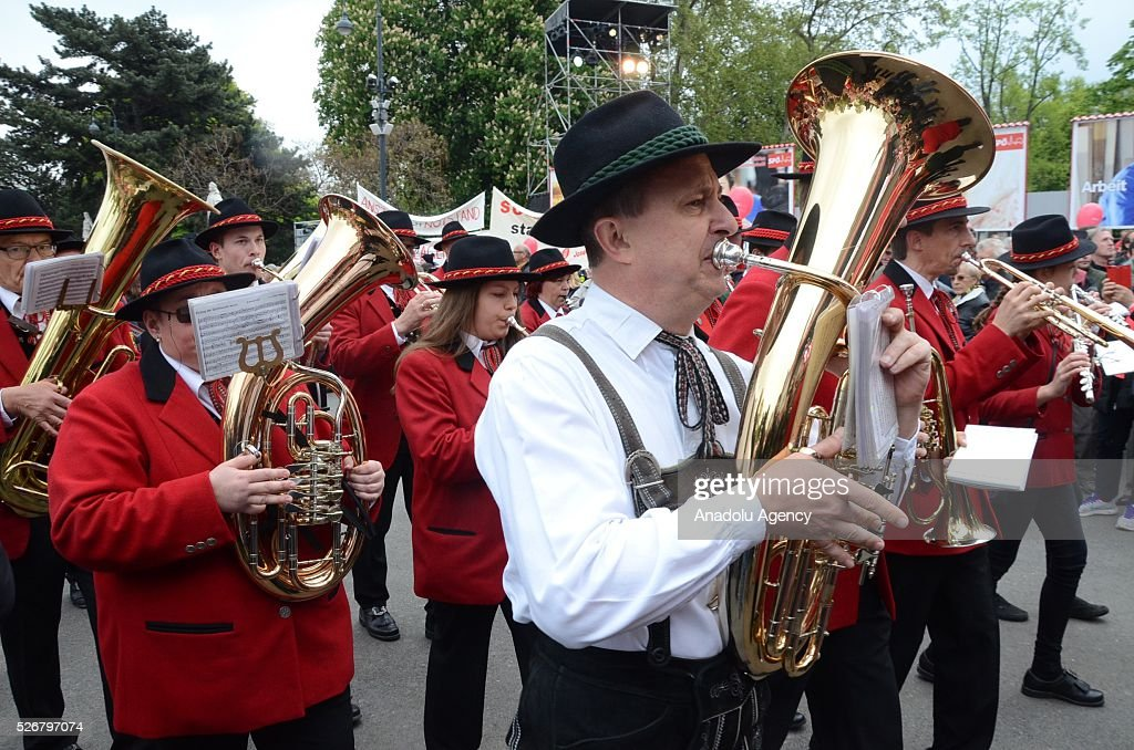Marching band performs during a rally to mark May Day, International Workers' Day, in front of municipal building in Vienna, capital city of Austria on May 1, 2016.