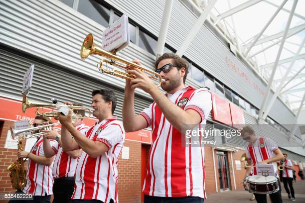 Marching band play music outside the stadium prior to the Premier League match between Southampton and West Ham United at St Mary's Stadium on August...