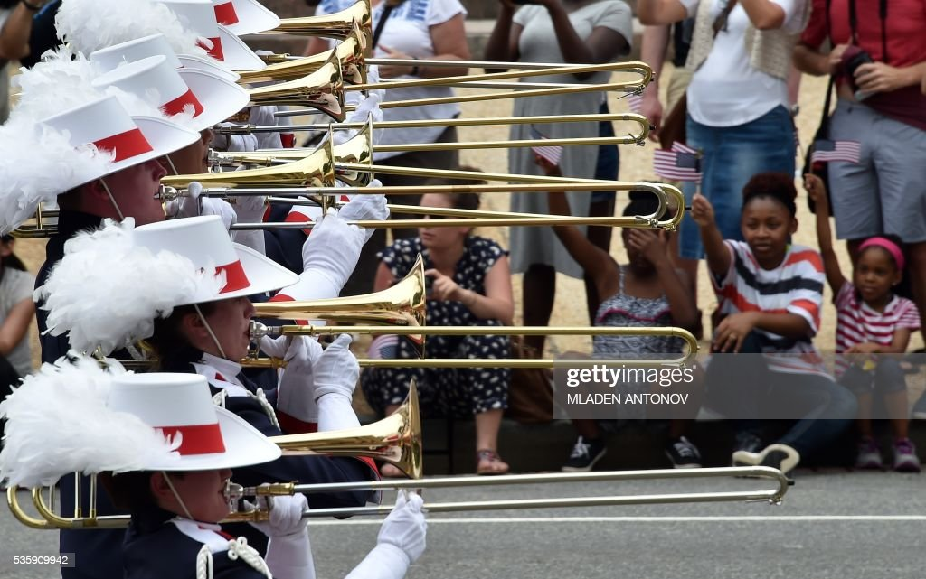 A marching band takes part in the Memorial Day Parade on Constitution Avenue on May 30, 2016 Washington DC. / AFP / MLADEN