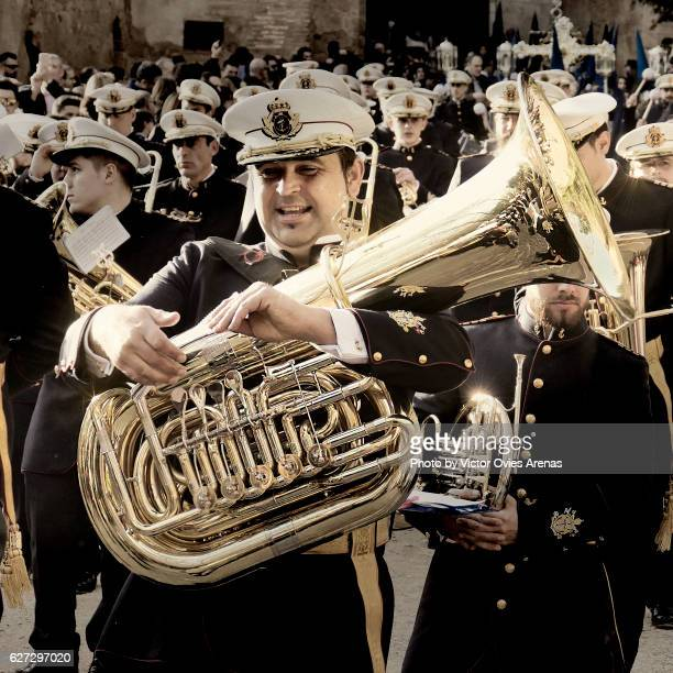 Marching band wearing military uniforms during an Easter religious parade in the Alhambra, Granada, Andalucia, Spain