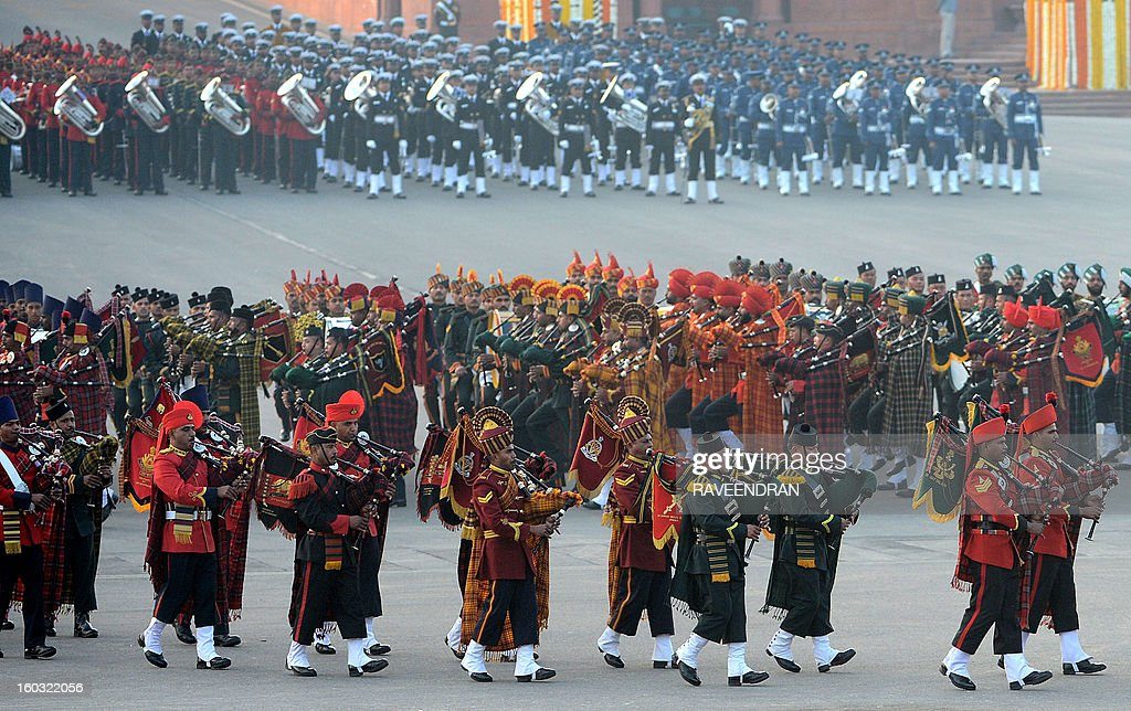 Marching bands from the Indian Army, Navy and Air Force march in front of the Central Secretariat and Parliament buildings during the Beating Retreat Ceremony at Vijay Chowk in New Delhi on January 29, 2013. The ceremony is a culmination of Republic Day celebrations and dates back to the days when troops disengaged themselves from battle at sunset. AFP PHOTO/RAVEENDRAN