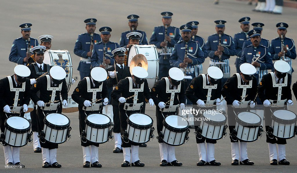 Marching bands from the Indian Army, Navy and Air Force march in front of the Central Secretariat and Parliament buildings during the Beating Retreat Ceremony at Vijay Chowk in New Delhi on January 29, 2013. The ceremony is a culmination of Republic Day celebrations and dates back to the days when troops disengaged themselves from battle at sunset.