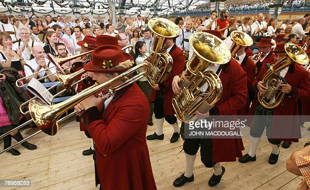A marching brass band enters a beer tent during the official opening of the Oktoberfest beer festival in Munich southern Germany 22 September 2007...
