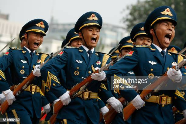 Marching honour guards shout as the chairman of the US Joint Chiefs of Staff General Joseph Dunford is welcomed by his Chinese counterpart during a...