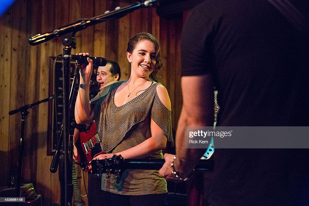 Marci Madison performs on stage with Chingon during the 'Sin City: A Dame to Kill For' premiere after party at The Rattle Inn on August 20, 2014 in Austin, Texas.