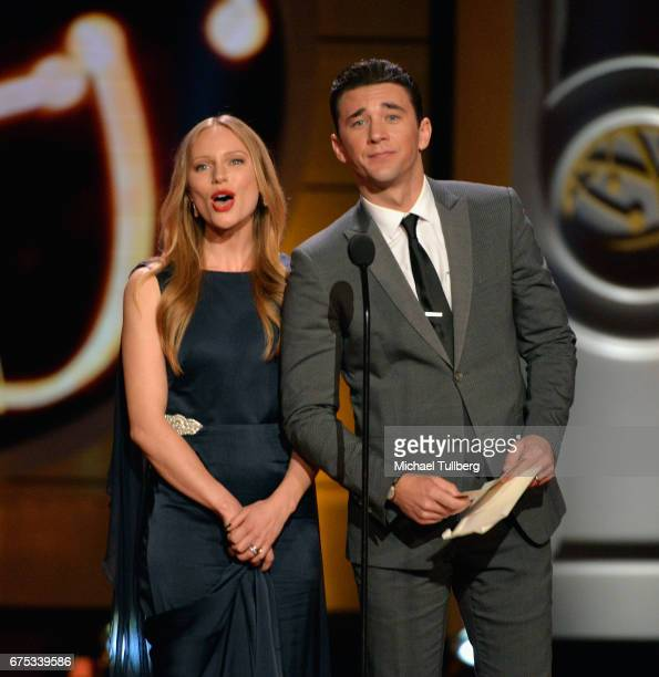 Marci Miller left and Billy Flynn present the award for outstanding entertainment talk show host at the 44th annual Daytime Emmy Awards at Pasadena...