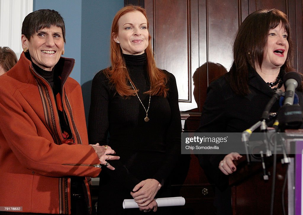 Marcia Cross (C), actress from ABC's 'Desperate Housewives,' participates in a news conference with Rep. Rosa DeLauro (D-CT) (L) and Lifetime Networks public affiars Vice President Meredith Wagner to raise awareness of the Breast Cancer Patient Protection Act on Capitol Hill January 23, 2008 in Washington, DC. Representing the Lifetime television network, Cross delivered 20 million signatures collected online that urge Congressto pass legislation to stop 'drive-through' mastectomies. Cross and other celebrities have joined Lifetime's 'Every Woman Counts' initiative to encourage women to vote, run for office and raise awarness of breast cancer.