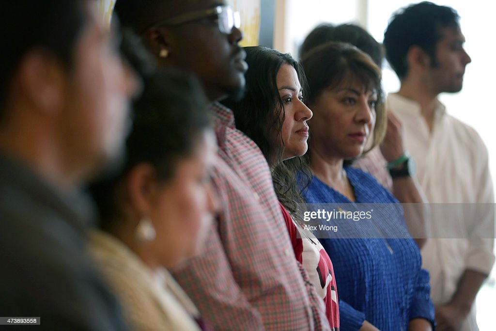 Marcia Cruz who was originally from El Salvador stands with other immigrant workers during a rally May 18 2015 at the headquarters of AFLCIO in...