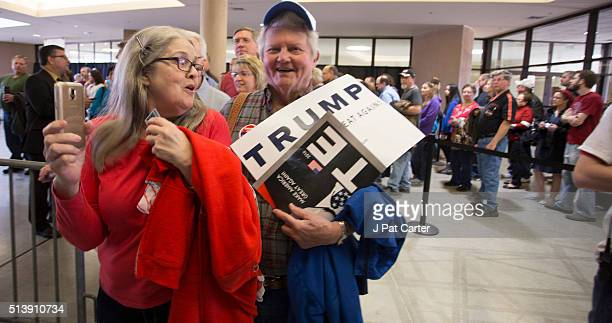 Marcia Kraft and Lynn Antrim wait in line to vote during the state's Republican caucus on March 5 2016 in Wichita Kansas People were standing in line...