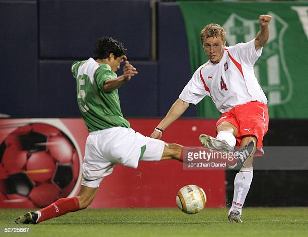 Marcin Baszczynski of Poland passes the ball away from Ricardo Osorio of Mexico during an international friendly on April 27 2005 at Soldier Field in...