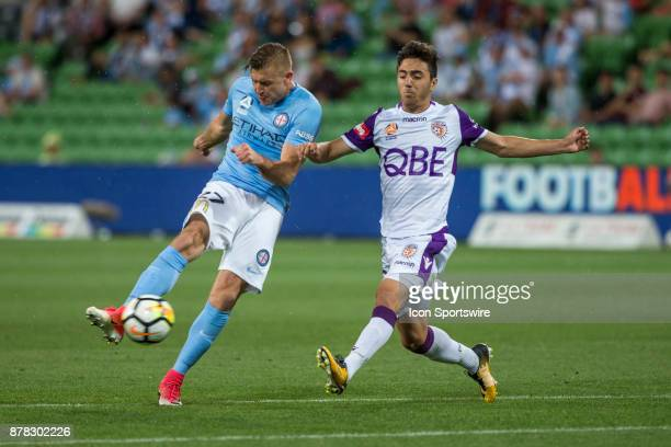 Marcin Budzinski of Melbourne City and Jacob Italiano of Perth Glory contest the ball during Round 8 of the Hyundai ALeague Series between Melbourne...