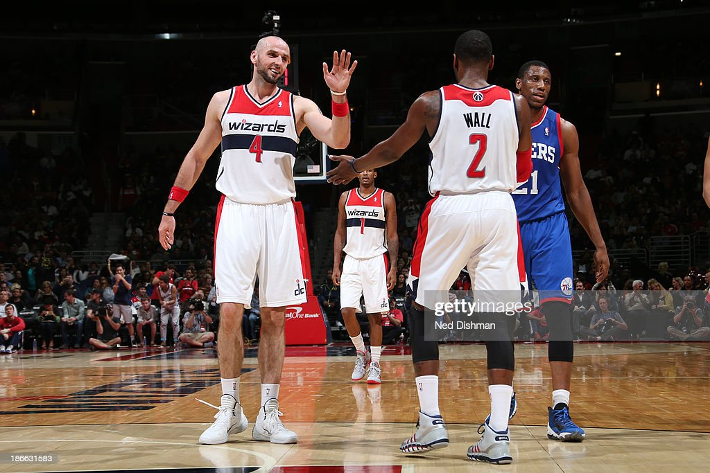 <a gi-track='captionPersonalityLinkClicked' href=/galleries/search?phrase=Marcin+Gortat&family=editorial&specificpeople=589986 ng-click='$event.stopPropagation()'>Marcin Gortat</a> #4 and <a gi-track='captionPersonalityLinkClicked' href=/galleries/search?phrase=John+Wall&family=editorial&specificpeople=2265812 ng-click='$event.stopPropagation()'>John Wall</a> #2 of the Washington Wizards celebrate a made basket against the Philadelphia 76ers at the Verizon Center on November 1, 2013 in Washington, DC.