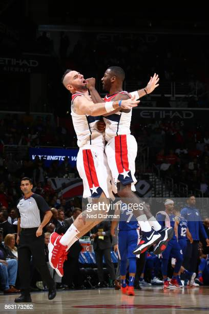 Marcin Gortat and John Wall of the Washington Wizards celebrate during the game against the Philadelphia 76ers on October 18 2017 at Capital One...