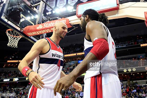 Marcin Gortat and Nene Hilario of the Washington Wizards celebrate after during the second half of the Wizards 112108 overtime win over the Brooklyn...