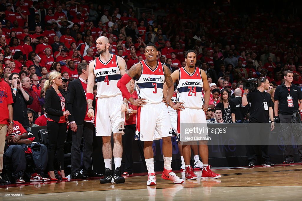 Marcin Gortat #4, Bradley Beal #3 and Andre Miller #24 of the Washington Wizards on the court in Game Three of the Eastern Conference Quarterfinals during the 2014 NBA Playoffs at the Verizon Center against the Chicago Bulls on April 25, 2014 in Washington, DC.