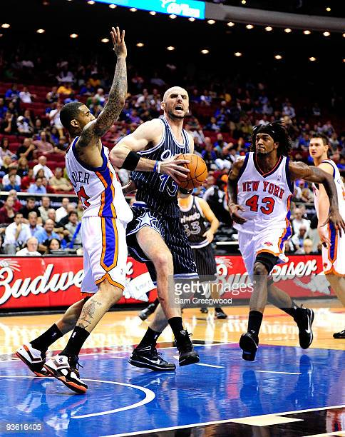 Marcin Gortat of the Orlando Magic attempts a shot against Wilson Chandler of the New York Knicks during the game at Amway Arena on December 2 2009...