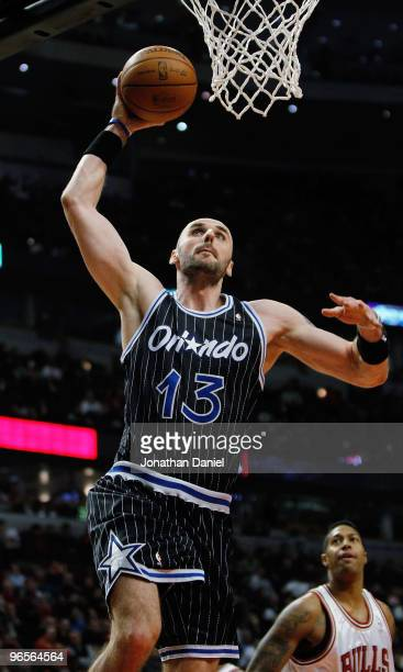 Marcin Gortat of the Orlando Magic goes up for a dunk against the Chicago Bulls at the United Center on February 10 2010 in Chicago Illinois The...