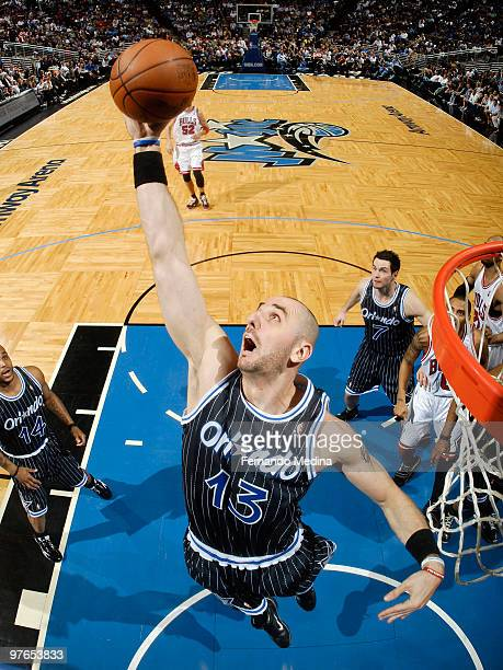 Marcin Gortat of the Orlando Magic reaches back for a rebound against the Chicago Bulls during the game on March 11 2010 at Amway Arena in Orlando...
