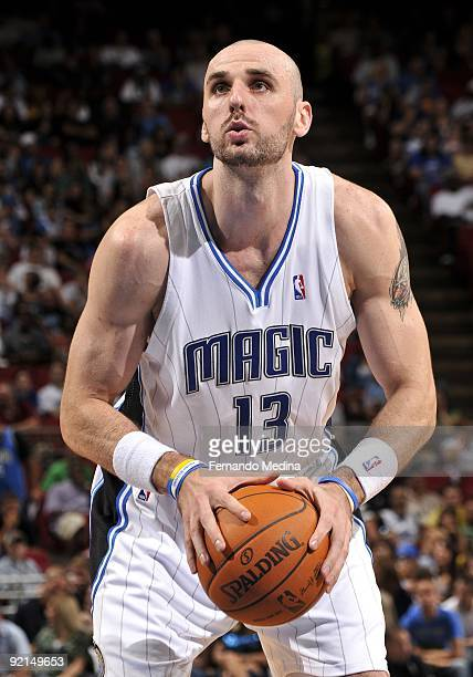 Marcin Gortat of the Orlando Magic shoots a free throw during the preseason game against the Houston Rockets on October 9 2009 at Amway Arena in...
