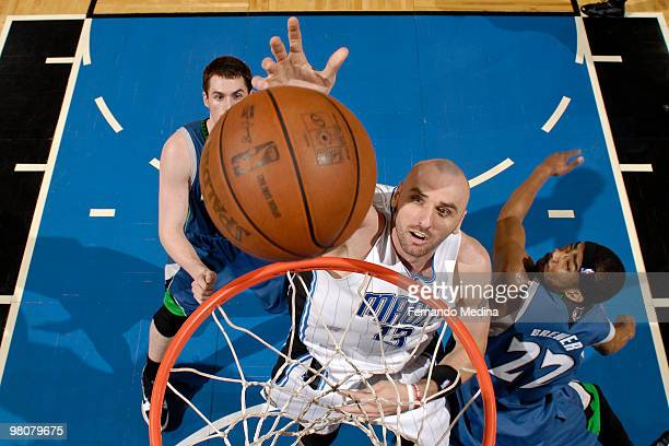 Marcin Gortat of the Orlando Magic shoots against Corey Brewer of the Minnesota Timberwolves during the game on March 26 2010 at Amway Arena in...