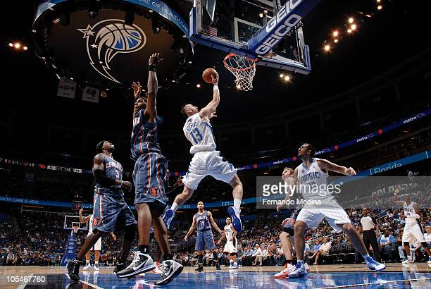 Marcin Gortat of the Orlando Magic shoots against the Charlotte Bobcats on October 14 2010 at Amway Center in Orlando Florida NOTE TO USER User...