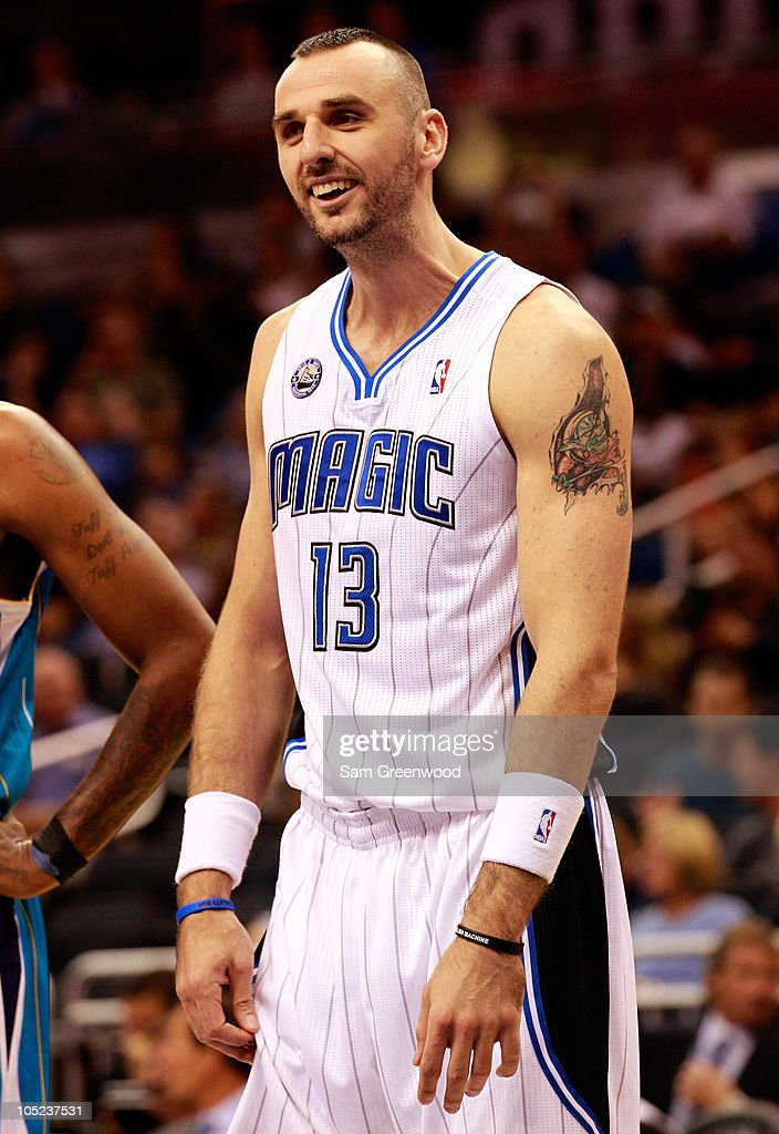 <a gi-track='captionPersonalityLinkClicked' href=/galleries/search?phrase=Marcin+Gortat&family=editorial&specificpeople=589986 ng-click='$event.stopPropagation()'>Marcin Gortat</a> #13 of the Orlando Magic smiles during the game against the New Orleans Hornets at Amway Arena on October 10, 2010 in Orlando, Florida.