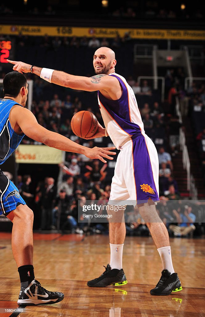 Marcin Gortat #4 of the Phoenix Suns directs a teammate against the Orlando Magic on December 9, 2012 at U.S. Airways Center in Phoenix, Arizona.