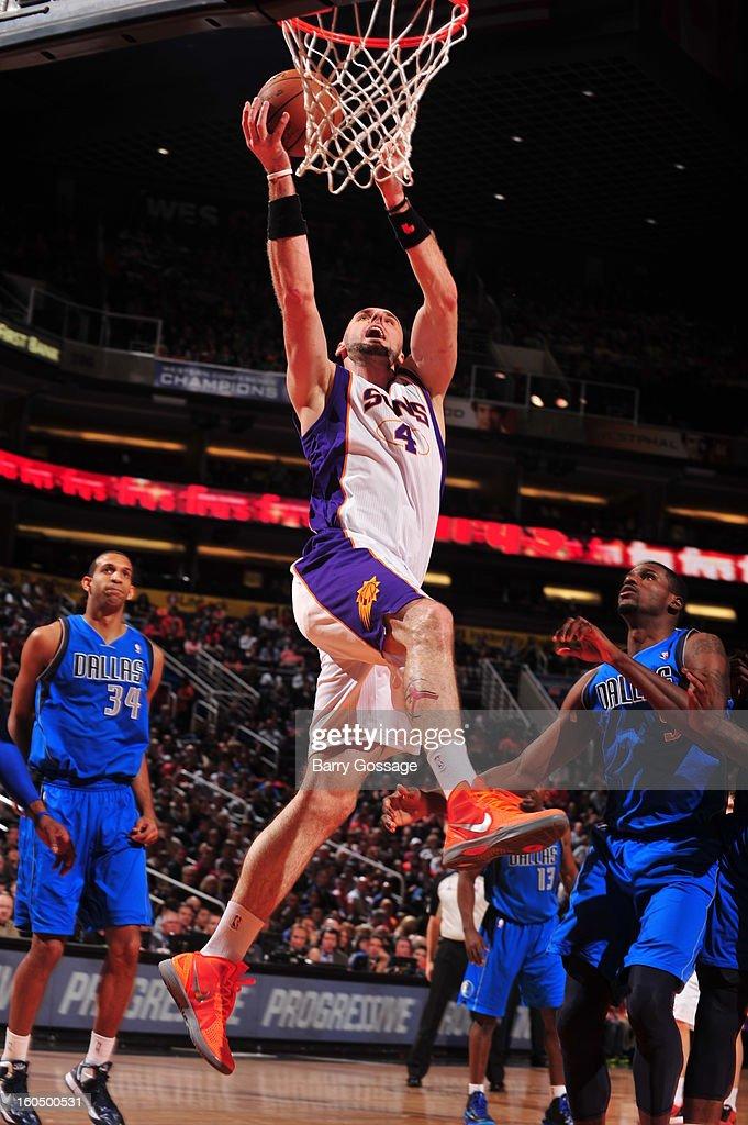 Marcin Gortat #4 of the Phoenix Suns drives for a shot against the Dallas Mavericks on February 1, 2013 at U.S. Airways Center in Phoenix, Arizona.