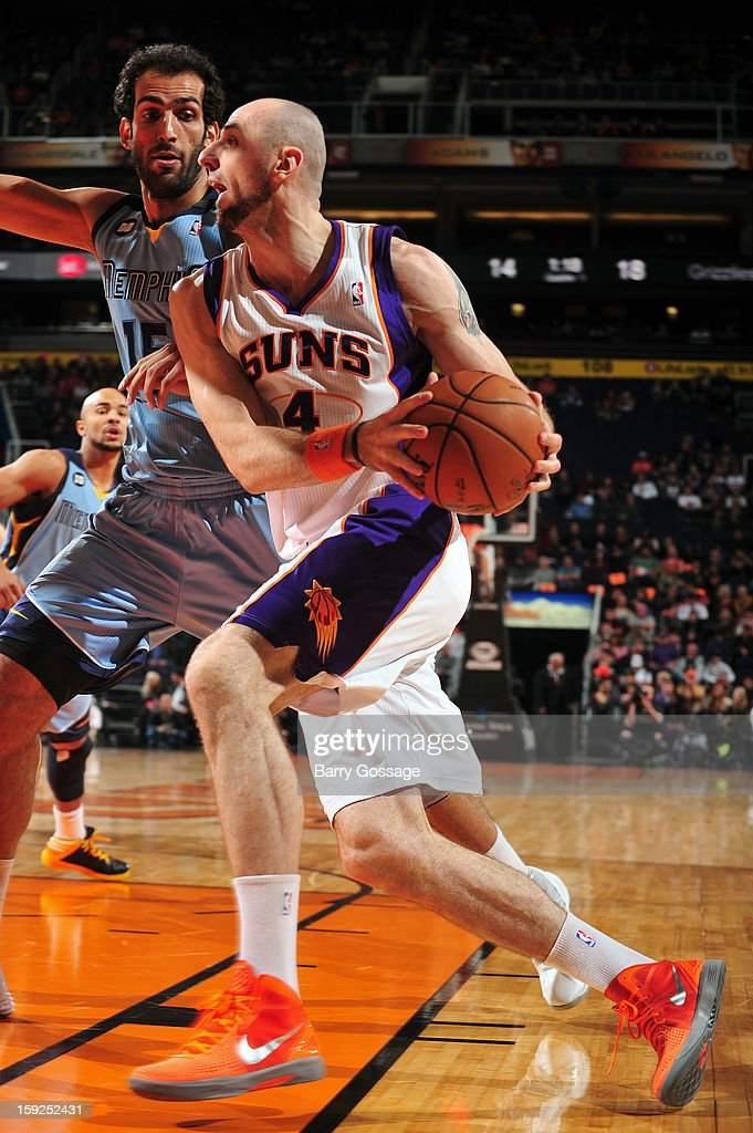 <a gi-track='captionPersonalityLinkClicked' href=/galleries/search?phrase=Marcin+Gortat&family=editorial&specificpeople=589986 ng-click='$event.stopPropagation()'>Marcin Gortat</a> #4 of the Phoenix Suns drives to the basket against the Memphis Grizzlies on January 6, 2013 at U.S. Airways Center in Phoenix, Arizona.