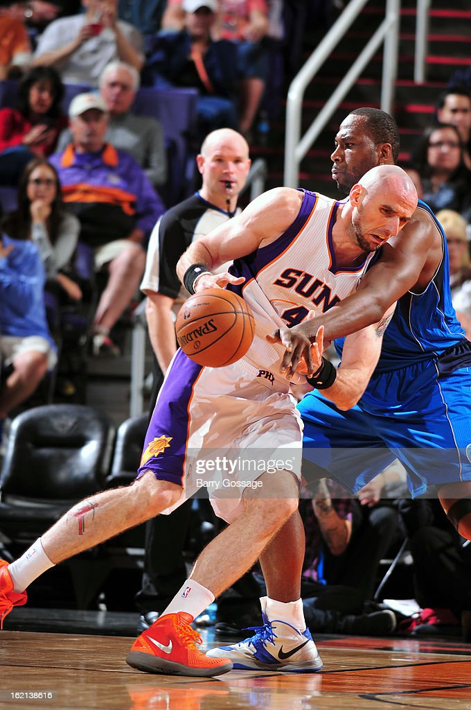 <a gi-track='captionPersonalityLinkClicked' href=/galleries/search?phrase=Marcin+Gortat&family=editorial&specificpeople=589986 ng-click='$event.stopPropagation()'>Marcin Gortat</a> #4 of the Phoenix Suns drives to the basket against the Dallas Mavericks on February 1, 2013 at U.S. Airways Center in Phoenix, Arizona.