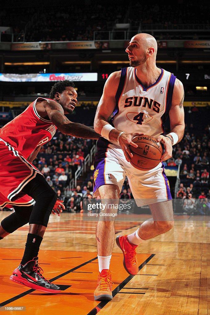 Marcin Gortat #4 of the Phoenix Suns drives to the hoop against Larry Sanders #8 of the Milwaukee Bucks on January 17, 2013 at U.S. Airways Center in Phoenix, Arizona.