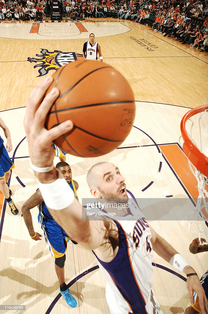 <a gi-track='captionPersonalityLinkClicked' href=/galleries/search?phrase=Marcin+Gortat&family=editorial&specificpeople=589986 ng-click='$event.stopPropagation()'>Marcin Gortat</a> #4 of the Phoenix Suns dunks against the Golden State Warriors in an NBA game played on March 18, 2011 at U.S. Airways Center in Phoenix, Arizona.